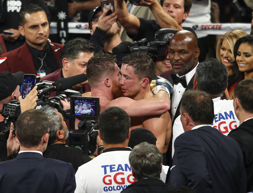 "Saul ""Canelo"" Alvarez and Gennady ҇GGӠGolovkin embrace after their middleweight championship boxing match at T-Mobile Arena in Las Vegas on Saturday, Sept. 16, 2017. The figh ..."