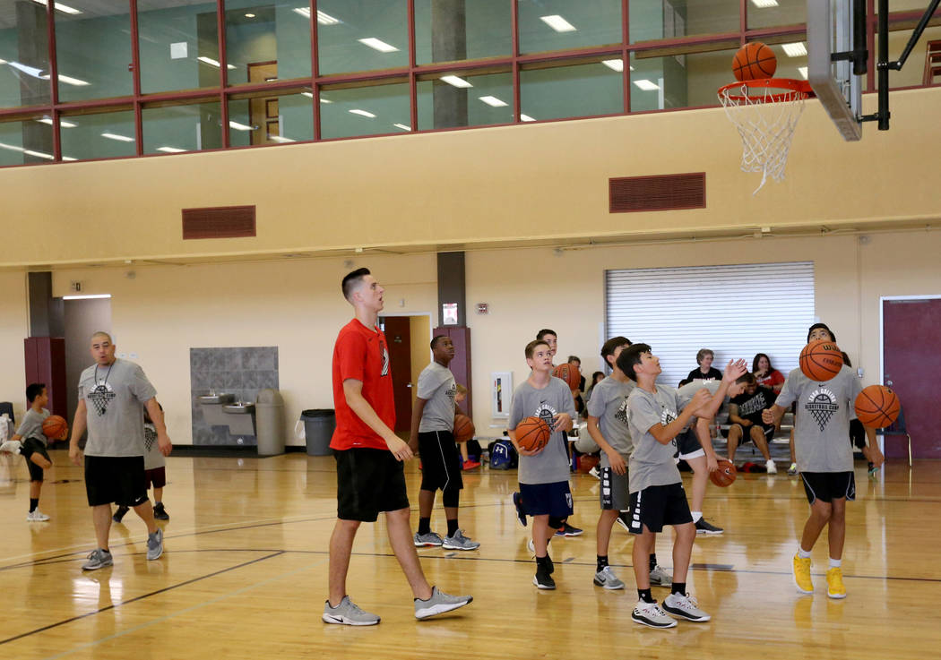 Portland Trail Blazers center and Las Vegas Native Zach Collins, left, runs his basketball camp at Bill and Lillie Heinrich YMCA in Las Vegas June 12, 2018. K.M. Cannon Las Vegas Review-Journal @K ...