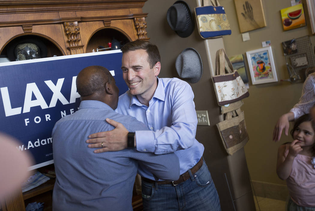 "Sherman Gray, left, owner of Avery's Coffee Shop, shakes hands with Adam Laxalt, a Republican running for governor, at a ""Get-Out-The-Vote"" campaign at Avery's Coffee Shop in Las Vegas, Wednesday, ..."