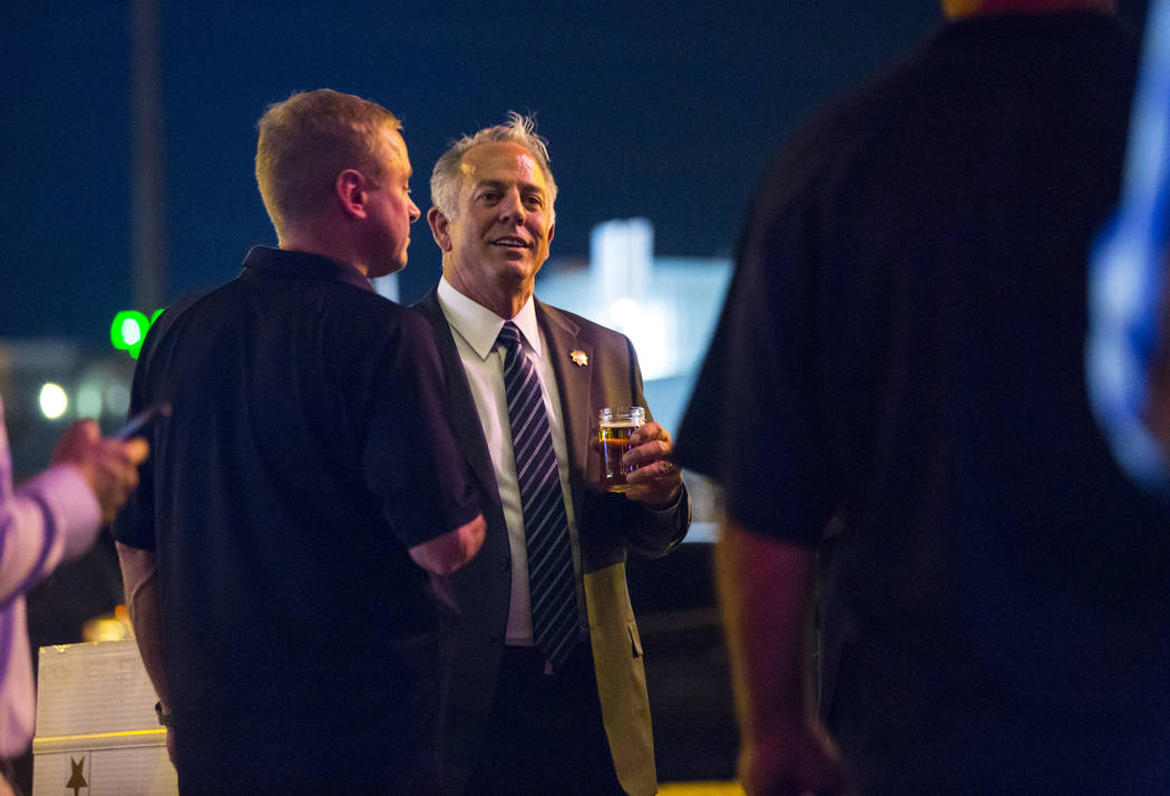 Clark County Sheriff Joe Lombardo, center, talks with Kevin McMahill, undersheriff, during Lombardo's election night watch party at La Comida in downtown Las Vegas on Tuesday, June 12, 2018. Chase ...