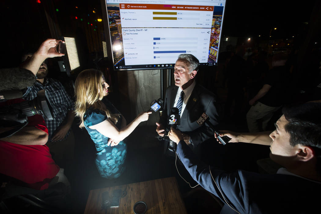 Clark County Sheriff Joe Lombardo responds to reporters after giving his victory speech during his election night watch party at La Comida in downtown Las Vegas on Tuesday, June 12, 2018. Chase St ...