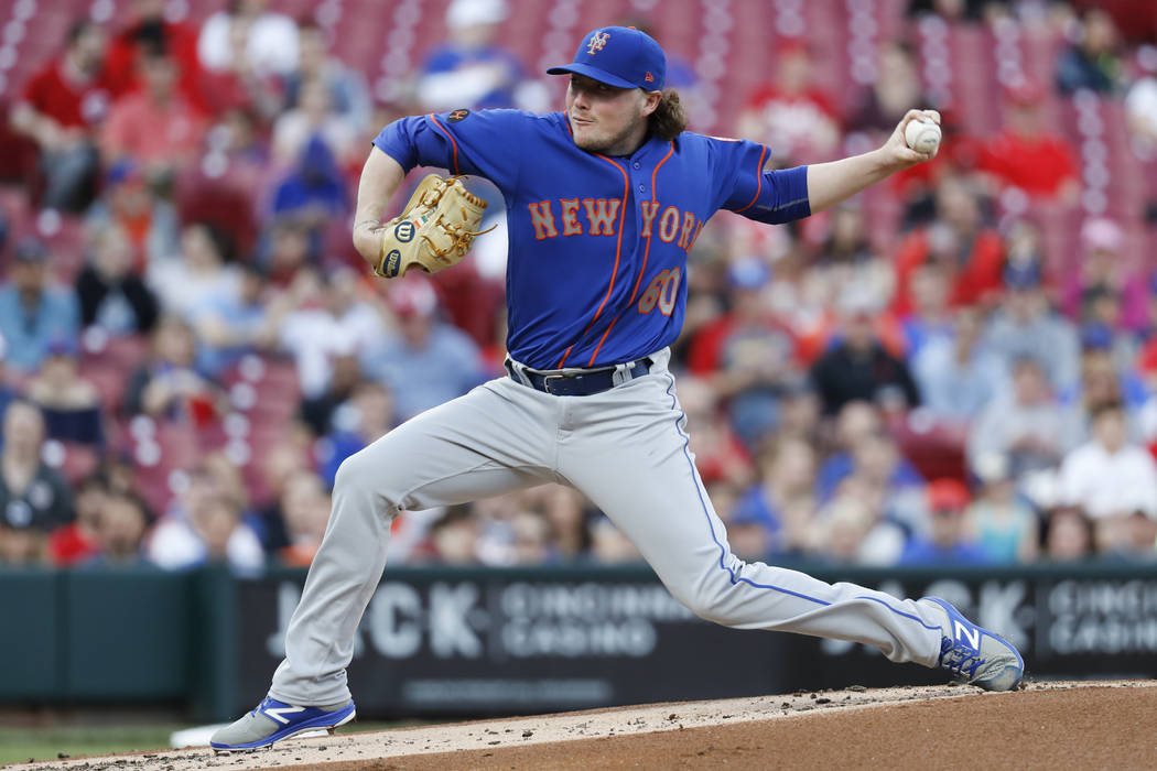New York Mets starting pitcher P.J. Conlon throws in the first inning of a baseball game against the Cincinnati Reds, Monday, May 7, 2018, in Cincinnati. (AP Photo/John Minchillo)