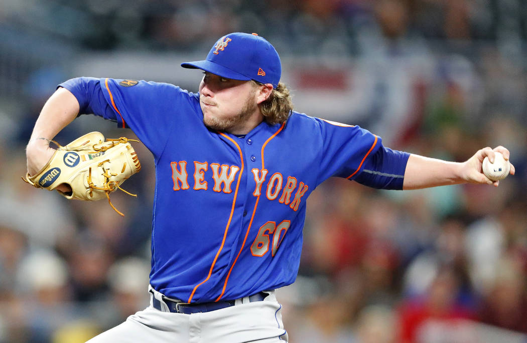 New York Mets starting pitcher P.J. Conlon (60) works in the first inning of the second game of a baseball doubleheader against the Atlanta Braves Monday, May 28, 2018, in Atlanta. (AP Photo/John ...