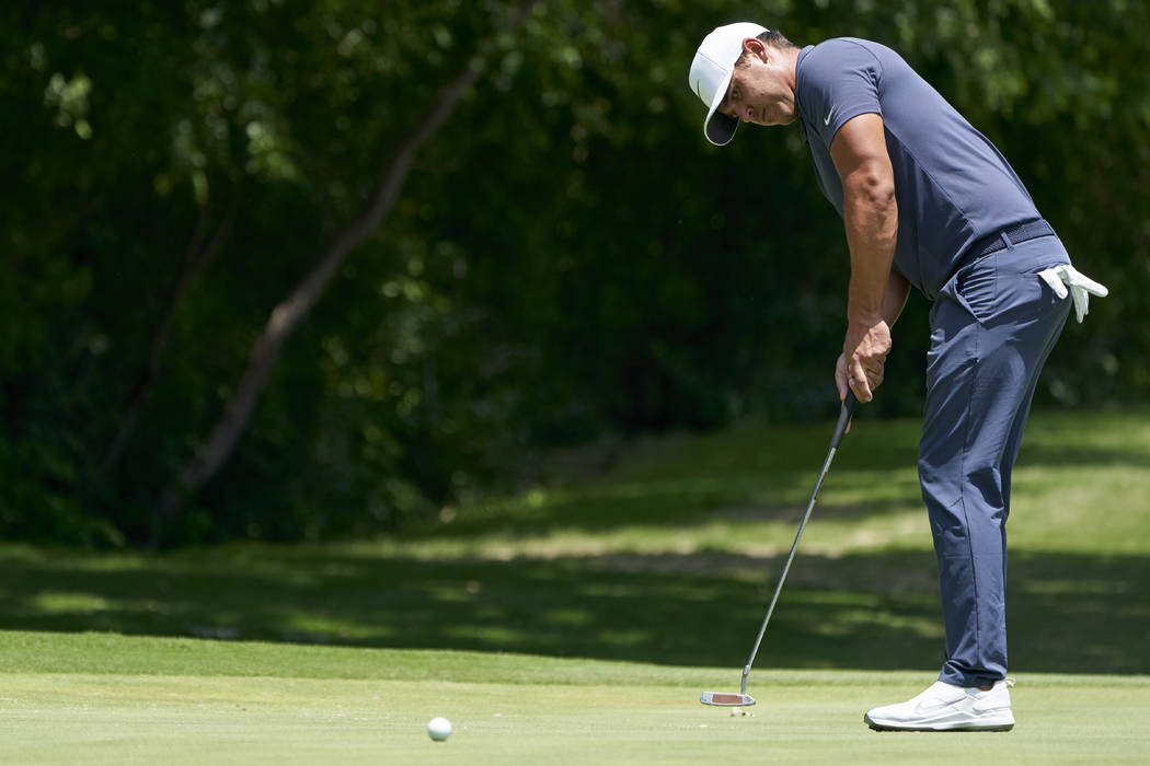 Brooks Koepka putts on the fifth hole during the final round of the Fort Worth Invitational golf tournament at Colonial Country Club in Fort Worth, Texas, Sunday, May 27, 2018. (AP Photo/Cooper Neill)