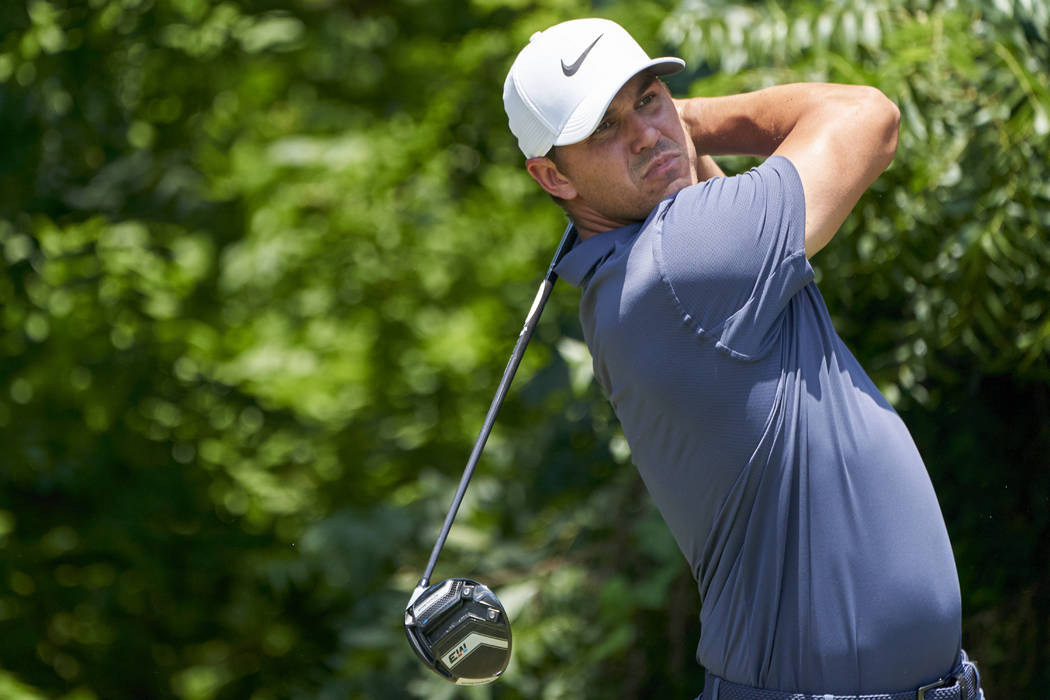 Brooks Koepka tees off on the sixth hole during the final round of the Fort Worth Invitational golf tournament at Colonial Country Club in Fort Worth, Texas, Sunday, May 27, 2018. (AP Photo/Cooper ...