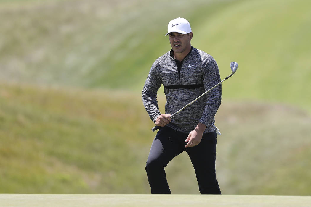 Brooks Koepka walks up to the 9th green during a practice round for the U.S. Open Golf Championship, Monday, June 11, 2018, in Southampton, N.Y. (AP Photo/Julie Jacobson)