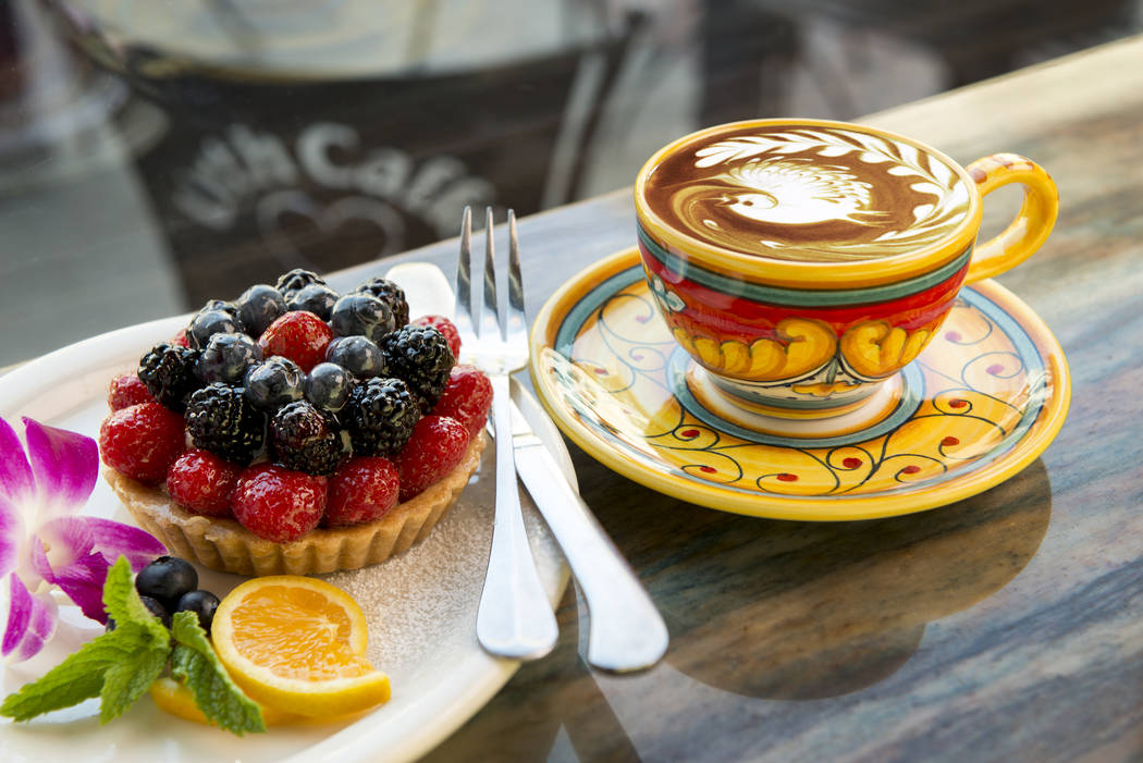 The signature Urth Caffe fruit tart and latte made with organic espresso. The coffee house has six locations in California and will open its first Las Vegas-area location in October. Victor Boghossian