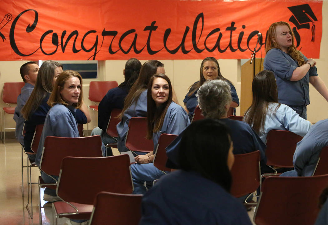 Inmates at the Women's Correctional Center, including Natasha Barker, center, wait for their graduation ceremony to begin on Wednesday, June 13, 2018, in Las Vegas. The College of Southern Nevada ...