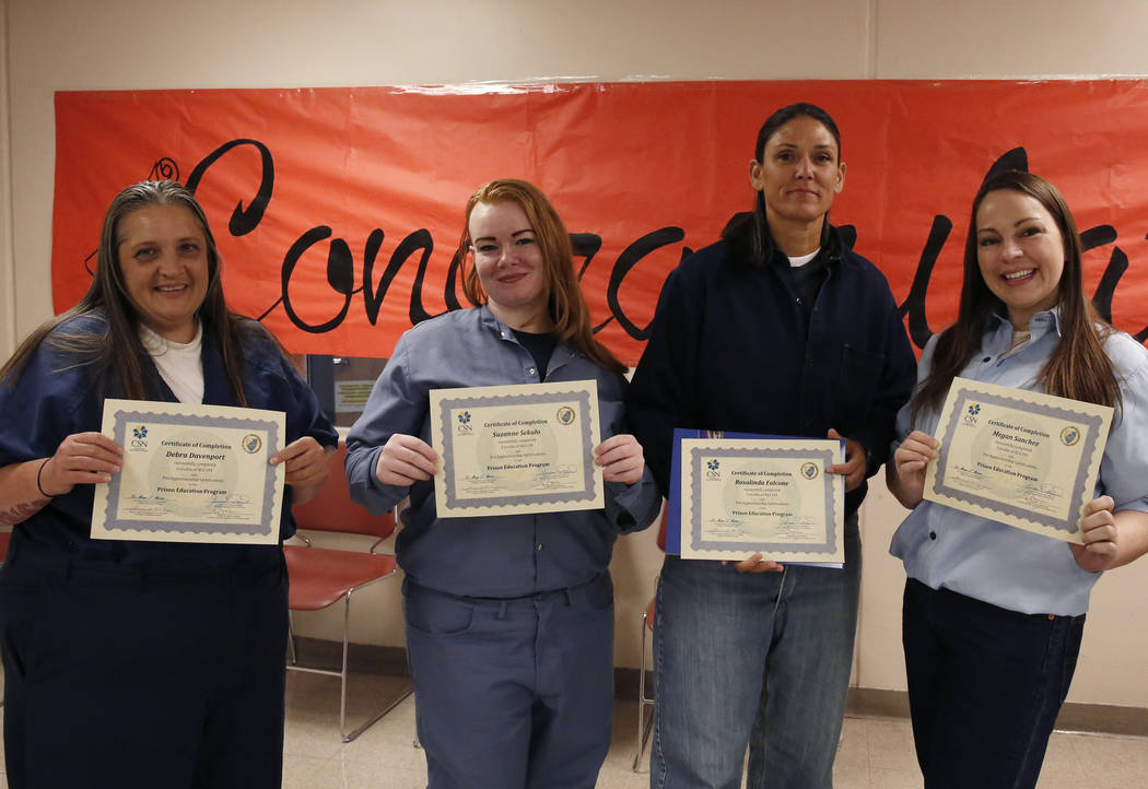Inmates at the Florence McClure Women's Correctional Center, Debra Davenport, left, Suzanne Sekulo, Rosalinda Falcone, and Megan Sanchez, right, show off their Academic Life Skill 101 certificate ...