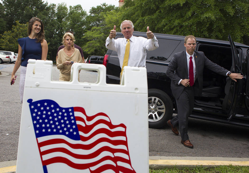 South Carolina Governor Henry McMaster gives a thumbs up as he arrives to vote in the South Carolina Primary, Tuesday, June 12, 2018 at the Lourie Center in Columbia, S.C. Arriving with McMaster i ...