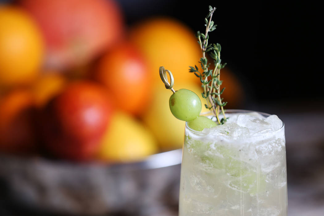 A Grape Thymes cocktail is served with Alexander Grappa, Italicus, grilled lemon sour, amaretto, San Pellegrino Limonata, grapes, and a sprig of thyme, at Pizzeria Monzú in Las Vegas, Tuesday ...