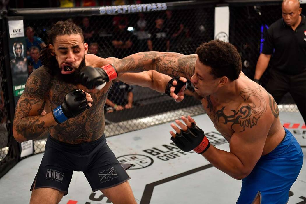 Greg Hardy has his hand raised in victory after defeating Austen Lane in a heavyweight bout during Dana White's Tuesday Night Contender Series at the TUF Gym on June 12, 2018, in Las Vegas. ( Jeff ...