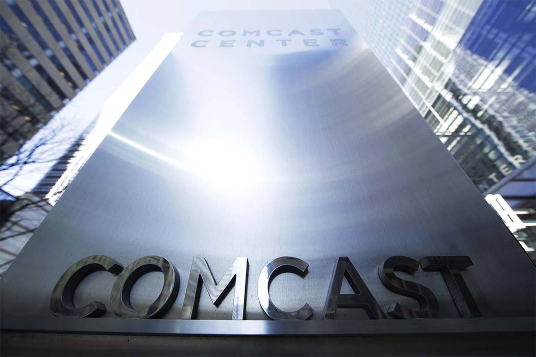 This March 29, 2017, file photo shows a sign outside the Comcast Center in Philadelphia. Disney has made a $52.4 billion all-stock offer for the bulk of Twenty-First Century Fox, including the stu ...