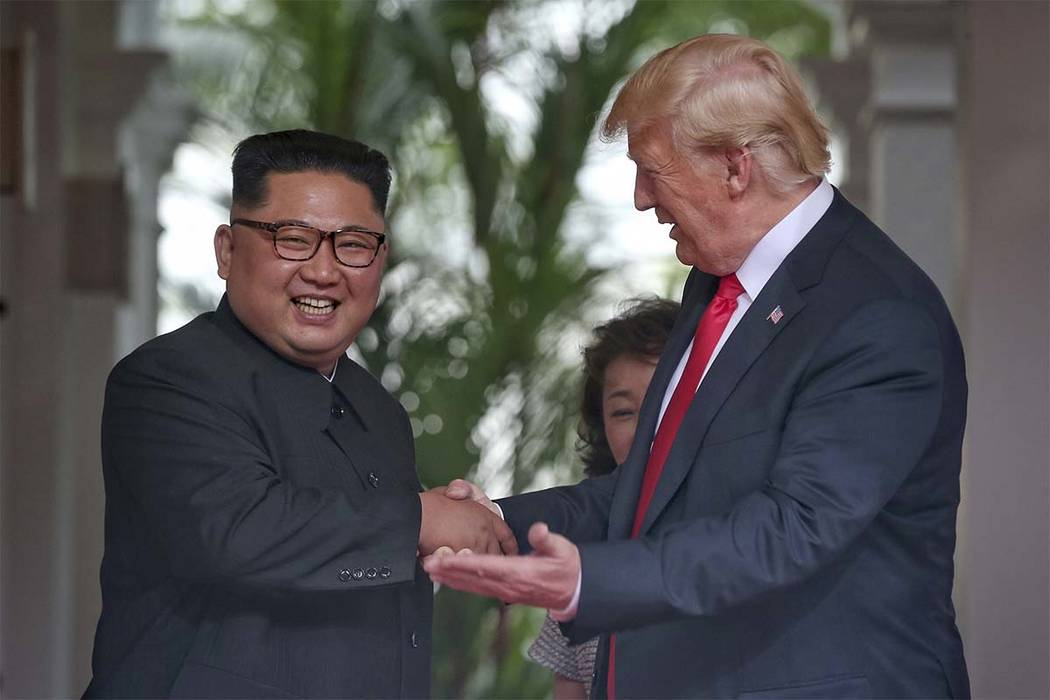 President Donald Trump shakes hands with North Korea leader Kim Jong Un at the Capella resort on Sentosa Island Tuesday, June 12, 2018 in Singapore. (Kevin Lim/The Straits Times via AP)
