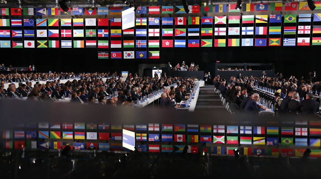 Delegates attend the FIFA congress on the eve of the opener of the 2018 soccer World Cup in Moscow, Russia, Wednesday, June 13, 2018. The congress in Moscow is set to choose the host or hosts for ...