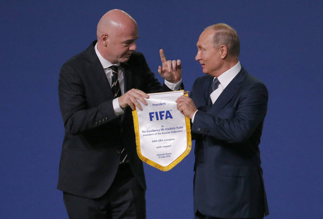 FIFA President Gianni Infantino, left, and Russian President Vladimir Putin pose for cameras at the FIFA congress on the eve of the opener of the 2018 soccer World Cup in Moscow, Russia, Wednesday ...