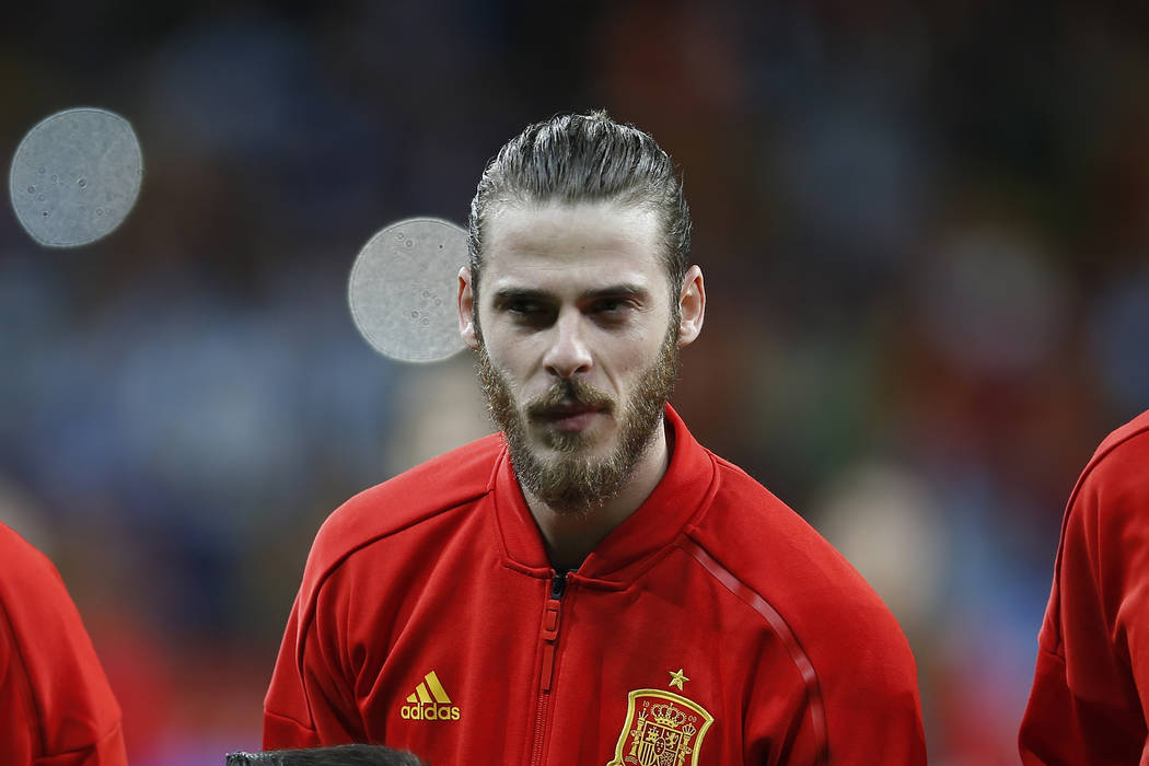 Spain's goalkeeper David de Gea listens to the national anthem before the international friendly soccer match between Spain and Argentina at the Wanda Metropolitano stadium in Madrid, Spain, Tuesd ...