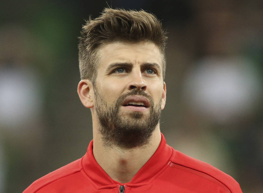 Spain's Gerard Pique listens to the national anthems before an international friendly soccer match between Spain and Tunisia in Krasnodar, Russia, Saturday, June 9, 2018. (AP Photo)