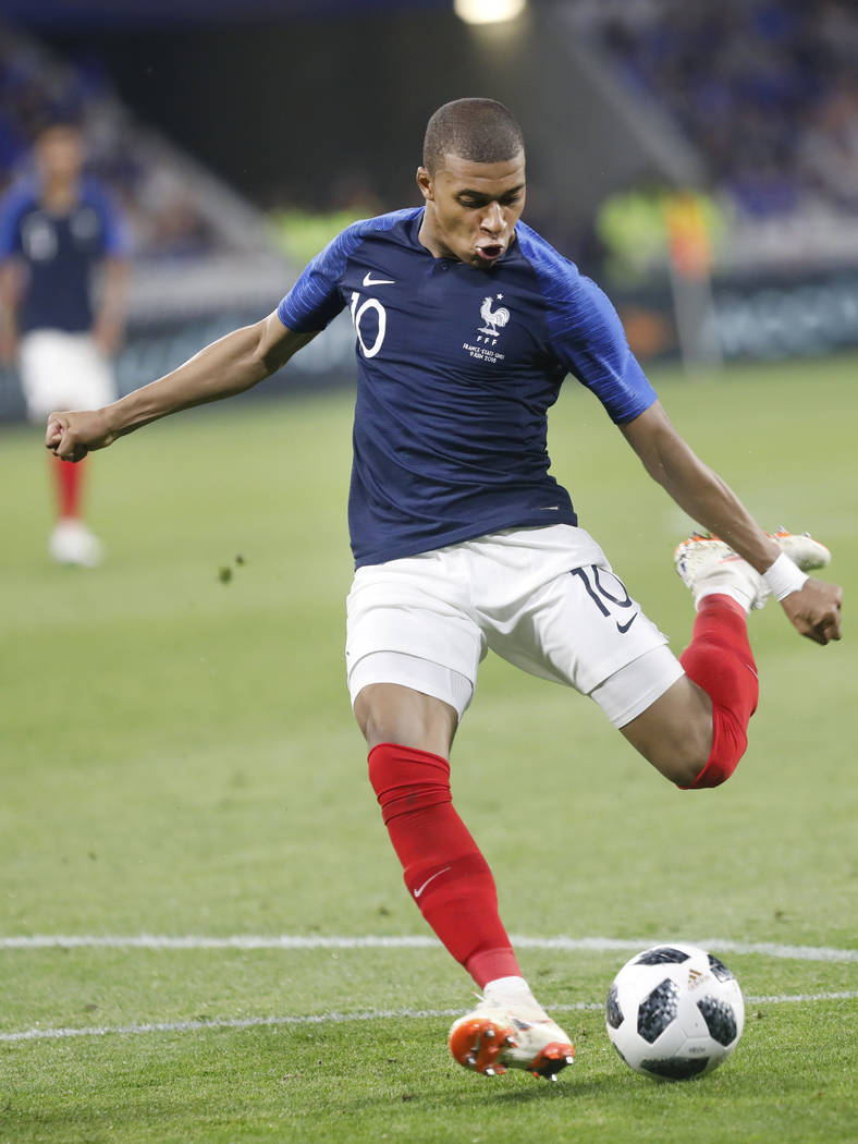 France's Kylian Mbappe kicks the ball during a friendly soccer match between France and USA at the Groupama stadium in Decines, near Lyon, central France, Saturday, June 9, 2018. (AP Photo/Laurent ...