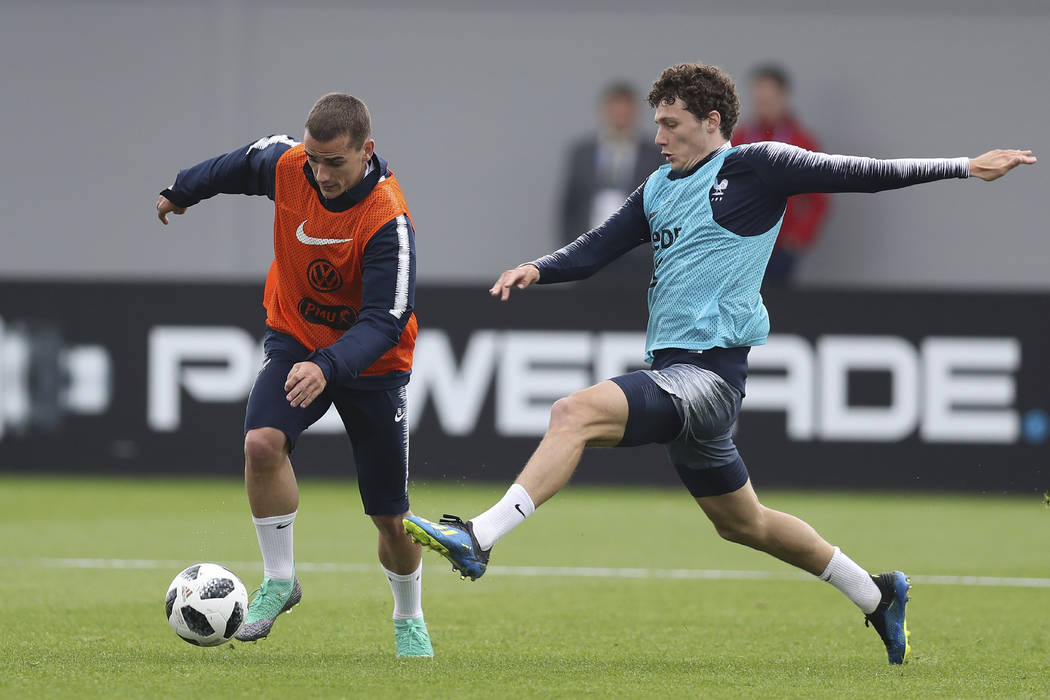 France's Antoine Griezmann controls the ball ahead Benjamin Pavard during a training session at the 2018 soccer World Cup in Glebovets, Russia, Tuesday, June 12, 2018. (AP Photo/David Vincent)