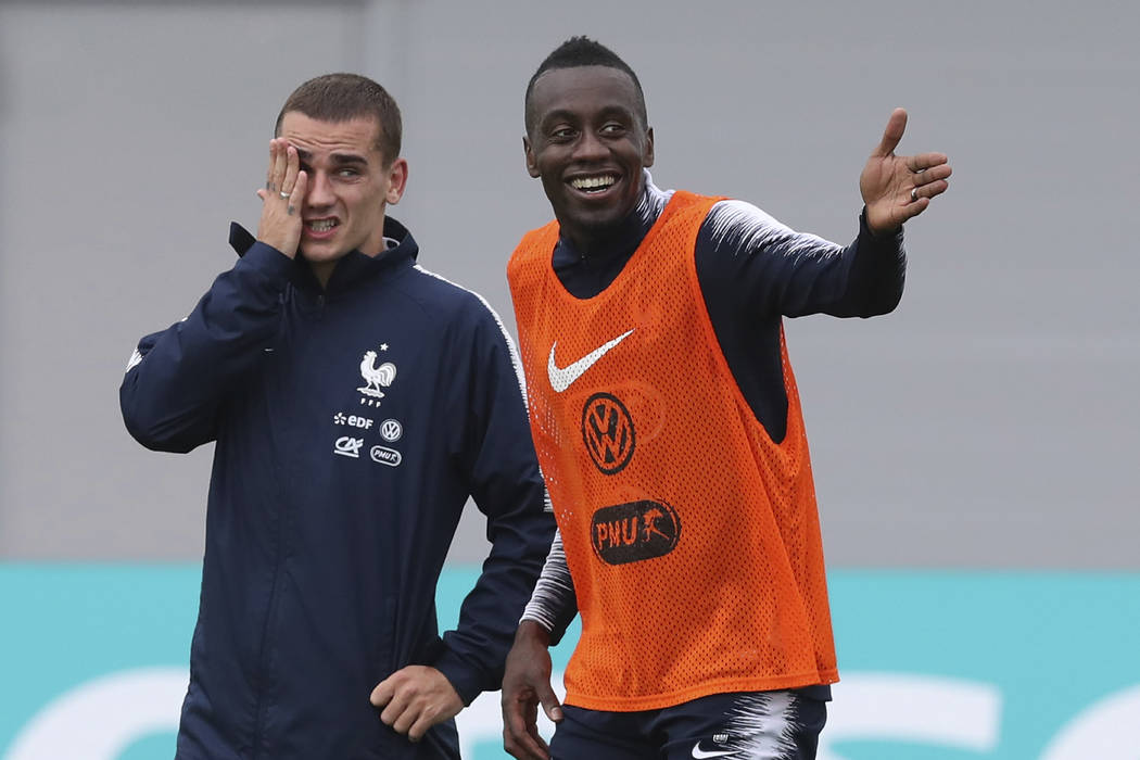 France's Antoine Griezmann and Blaise Matuidi smile during a training session at the 2018 soccer World Cup in Glebovets, Russia, Tuesday, June 12, 2018. (AP Photo/David Vincent)