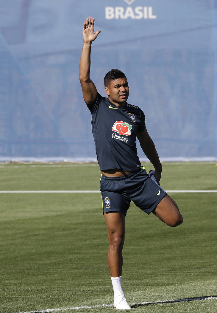 Brazil's Casemiro exercises during a training session in Sochi, Russia, Wednesday, June 13, 2018. Brazil will face Switzerland on June 17 in the group E for the soccer World Cup. (AP Photo/Andre P ...