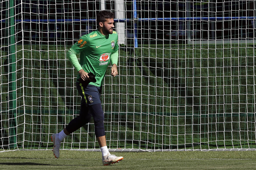 Brazil goalkeeper Alisson runs jogs during a training session in Sochi, Russia, Wednesday, June 13, 2018. Brazil will face Switzerland on June 17 in the group E for the soccer World Cup. (AP Photo ...