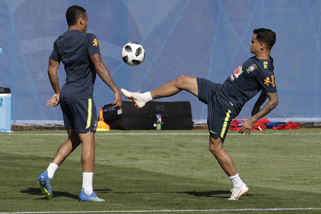 Brazil's soccer players Philippe Coutinho, right, and Gabriel Jesus practice during a training session in Sochi, Russia, Wednesday, June 13, 2018. Brazil will face Switzerland on June 17 in the gr ...