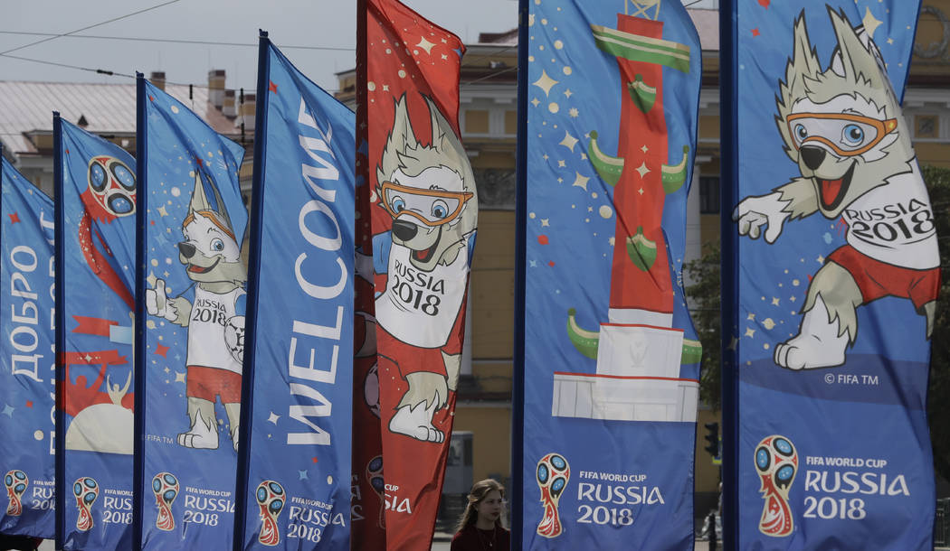 A woman walks past near the banners for the 2018 soccer World Cup in St. 52f94fbd1