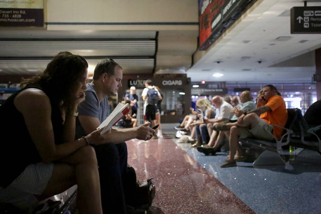 Passengers at baggage claim wait for the power to be restored at McCarran International Airport in Las Vegas on Wednesday, June 13, 2018. (Michael Quine/Las Vegas Review-Journal)