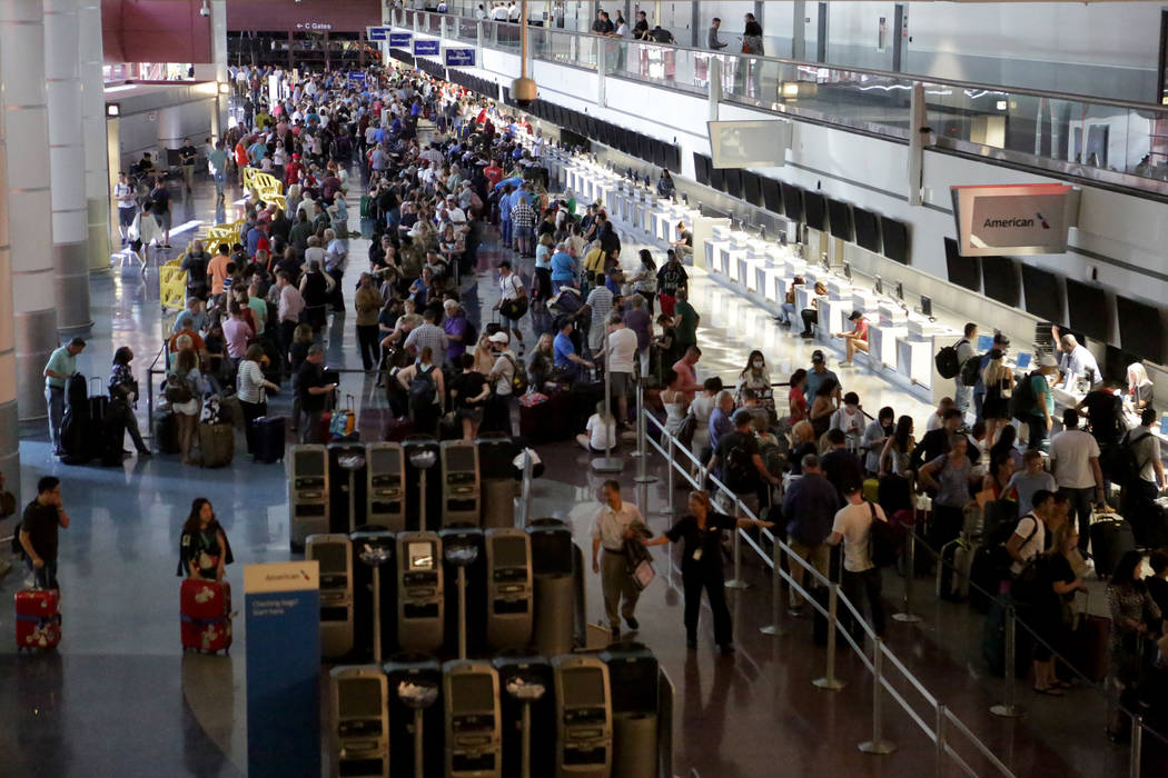 Hundreds of travelers jam the ticketing area of McCarran International Airport's Terminal 1 during a power outrage on Wednesday, June 13, 2018. Michael Quine Las Vegas Reviewjournal @Vegas88s