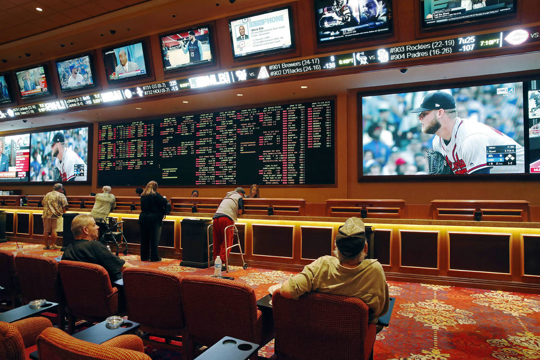People make bets in the sports book at the South Point in Las Vegas, May 14, 2018. The Borgata in Atlantic City, New Jersey, will start taking bets on sporting events on Thursday. (John Locher/AP, ...