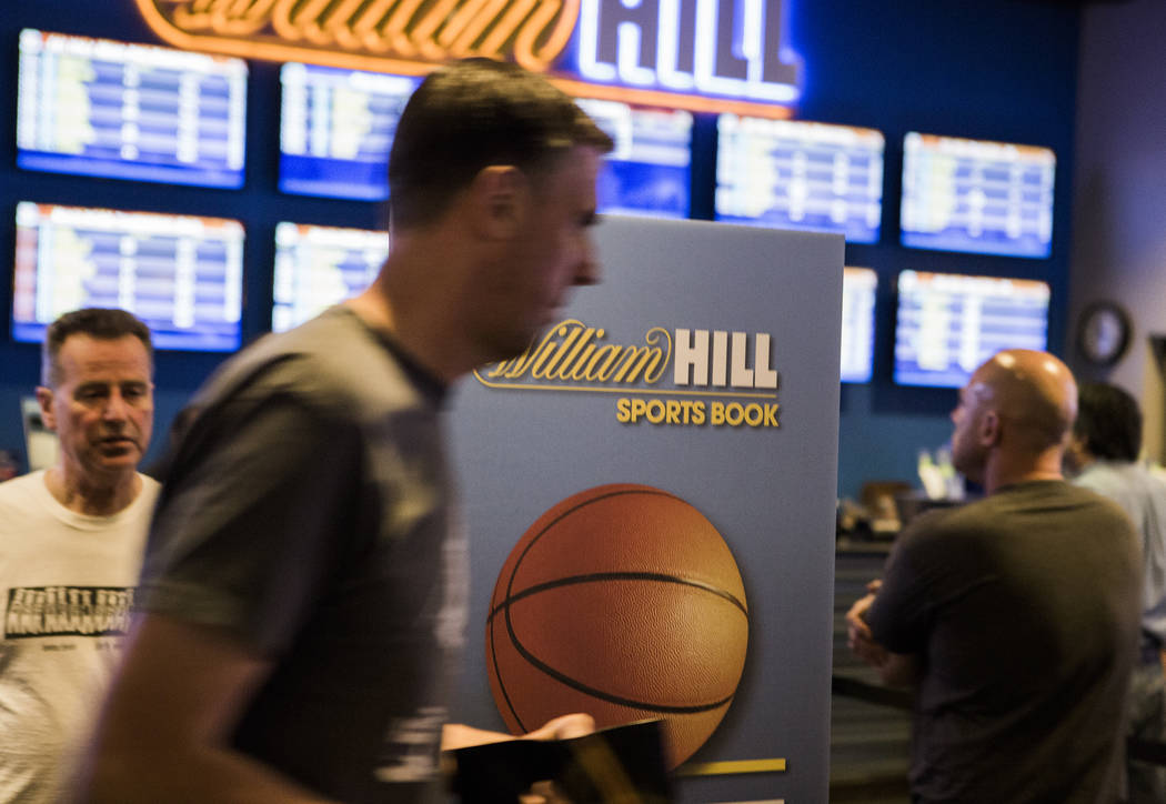 Men stand stand in line at the William Hill Race & Sports Book in the Plaza Hotel-Casino on Friday, March 18,2016. Jeff Scheid/Las Vegas Review-Journal Follow @jlscheid