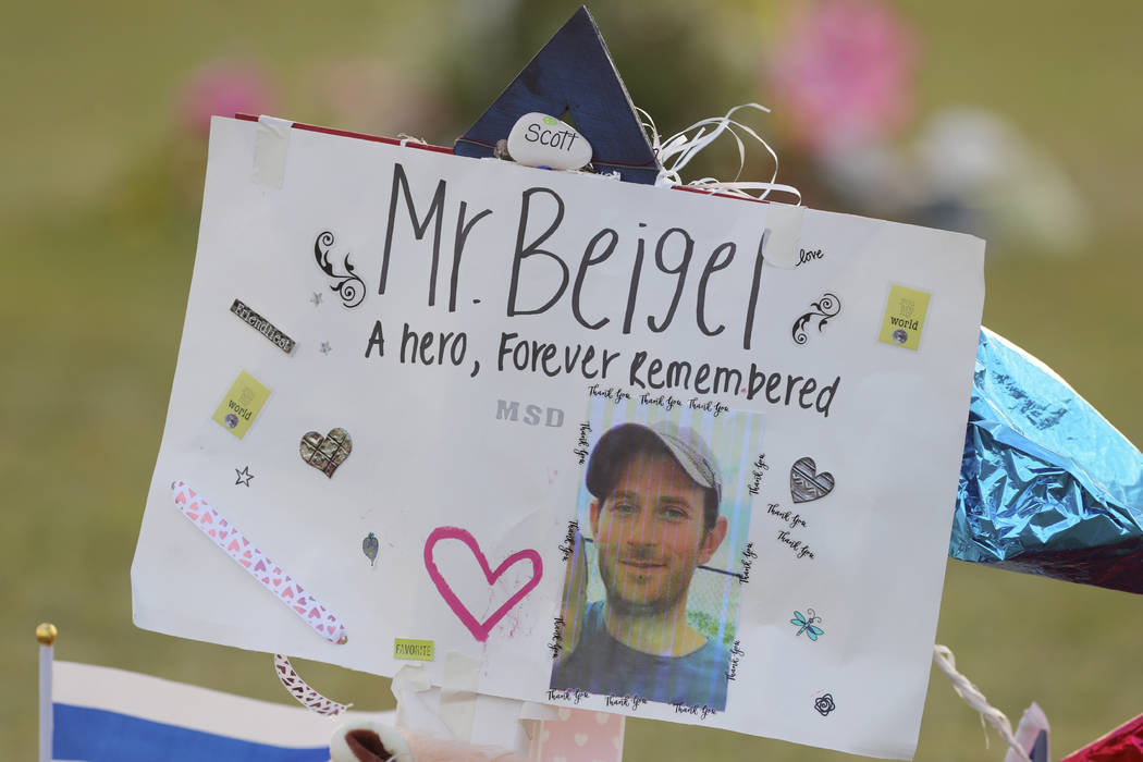 In this Feb. 20, 2018 file photo, a memorial for Geography teacher and cross-country coach, Scott Beigel is shown at Pine Trails Park in Parkland, Fla. (Mike Stocker/South Florida Sun-Sentinel via ...