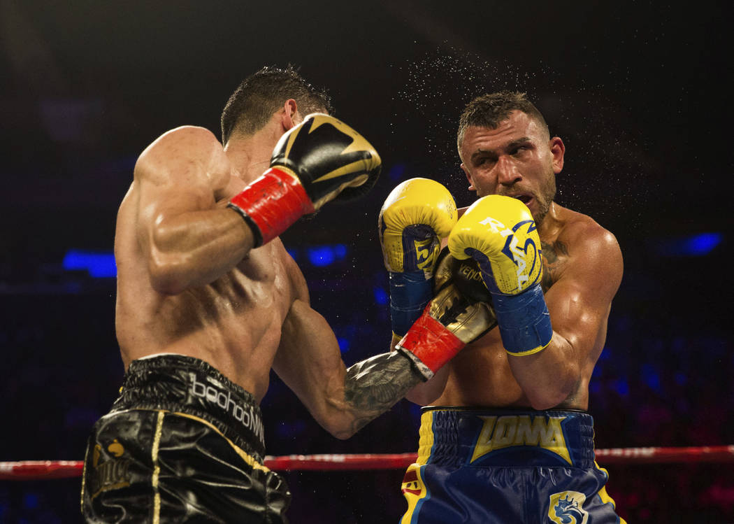 Jorge Linares,left, of Venezuela, connects with Vasiliy Lomachenko, of Ukraine, during their WBA lightweight championship boxing match Saturday, May 12, 2018, in New York. (AP Photo/Kevin Hagen)