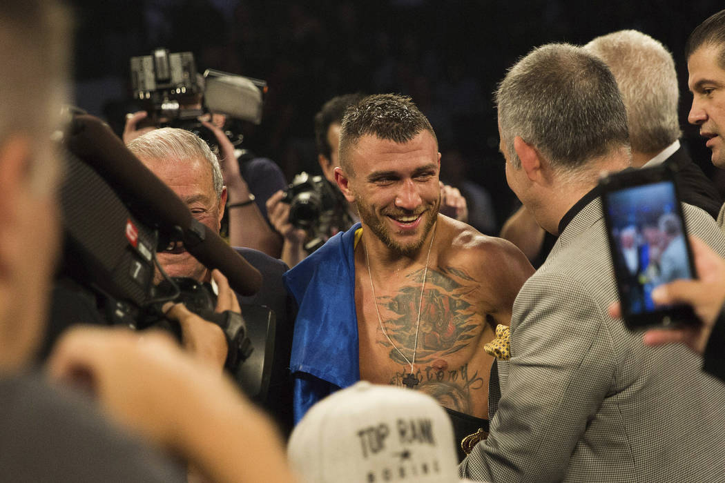 Vasiliy Lomachenko, of Ukraine, smiles after his victory against Jorge Linares, of Venezuela, during their WBA lightweight championship boxing match Saturday, May 12, 2018, in New York. (AP Photo/ ...