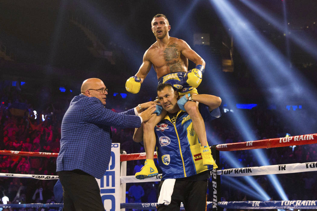 Vasiliy Lomachenko, of Ukraine, celebrates after his victory against Jorge Linares, of Venezuela, during their WBA lightweight championship boxing bout Saturday, May 12, 2018, in New York. (AP Pho ...