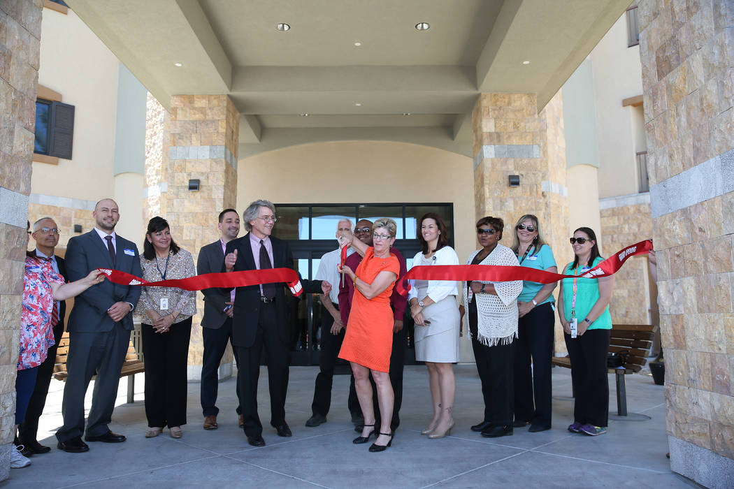 Clark County Commissioner Chris Giunchigliani, center, during the ribbon cutting ceremony of the Patriot Place Apartments in Las Vegas, Thursday, June 14, 2018. Erik Verduzco Las Vegas Review-Jour ...