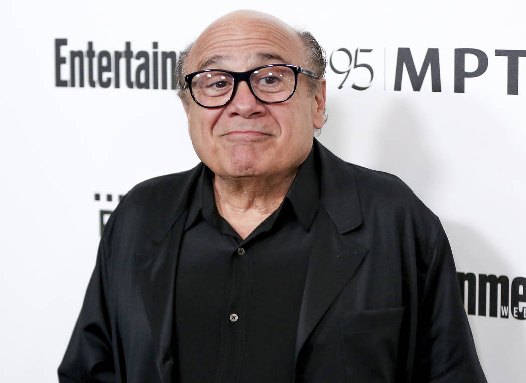 FILE - In this April 7, 2016 file photo, Danny DeVito arrives at the 5th Annual Reel Stories, Real Lives Benefit in Los Angeles. Disney has released its first teaser trailer for Tim Burton&#x2019 ...