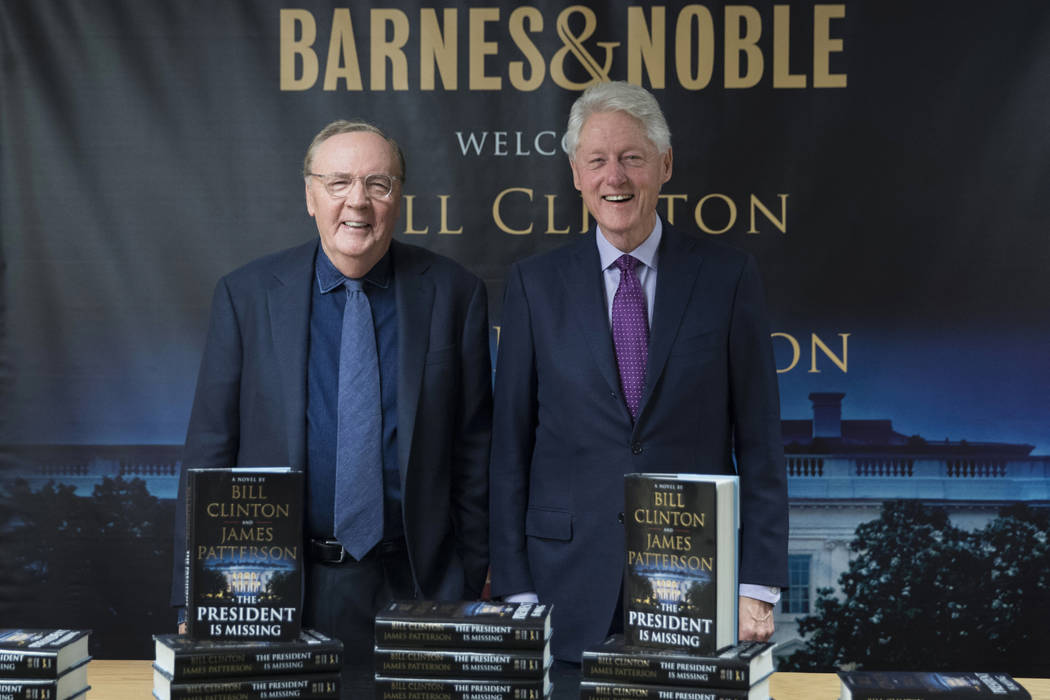 "In this June 5, 2018 file photo, former President Bill Clinton, right, and author James Patterson pose for photographers during an event to promote their new novel, ""The President is Missing,"" in ..."