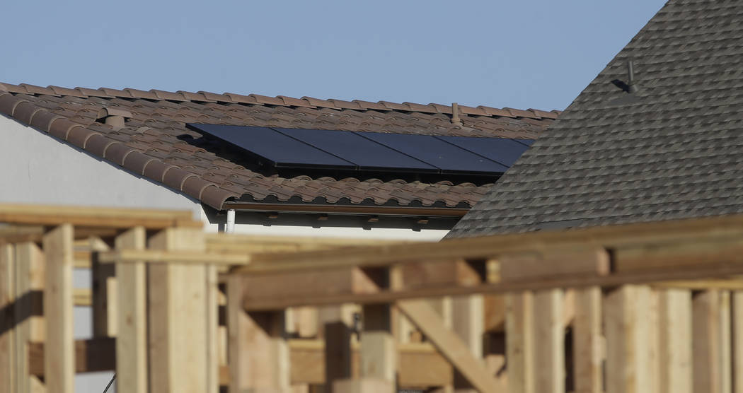 In this photo taken Monday, May 7, 2018, solar panels are seen on the rooftop on a home in a new housing project in Sacramento, Calif. The California Energy Commission will take up a proposal, Wed ...