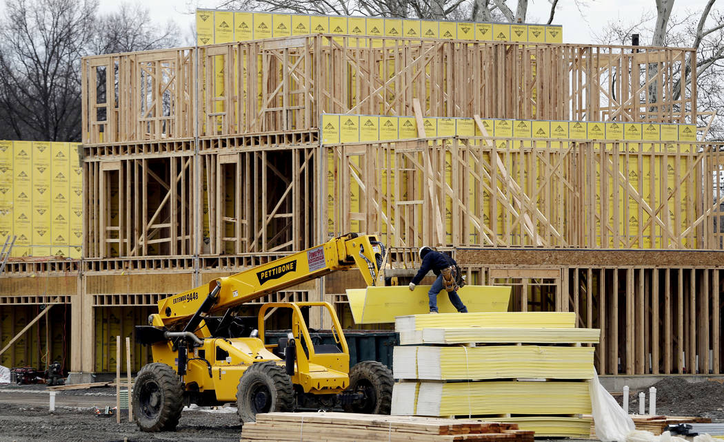 FILE- In this Feb. 26, 2018, file photo, work continues on a new development in Fair Lawn, N.J. On Tuesday, May 15, the National Association of Home Builders/Wells Fargo releases its May index of ...