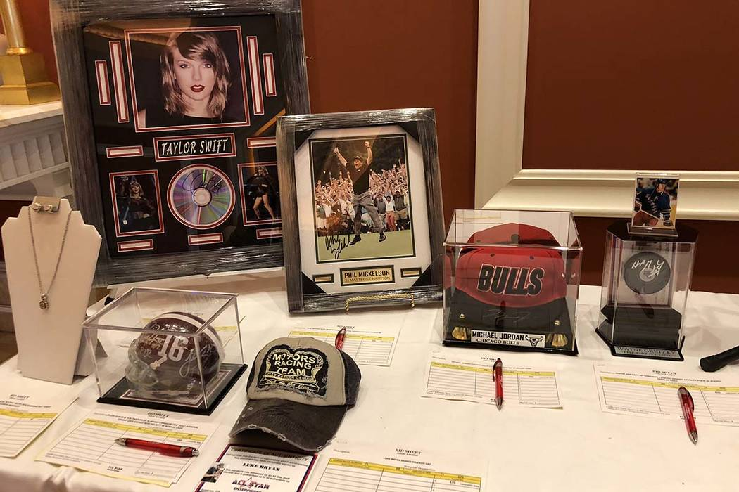 Signed memorabilia from a silent auction at the National Investor Relations Institute's annual conference. The silent auction raised $10,000 for Route 91 Strong, a nonprofit supporting survivors o ...