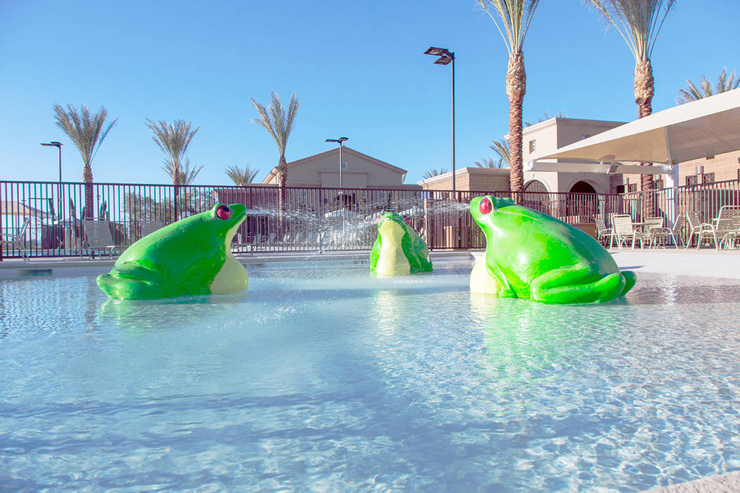 This large Vistas community pool features a waterslide, plus children's play lagoon with special frog water features. The pool is one of four resident-only pools in Summerlin. (Summerlin)