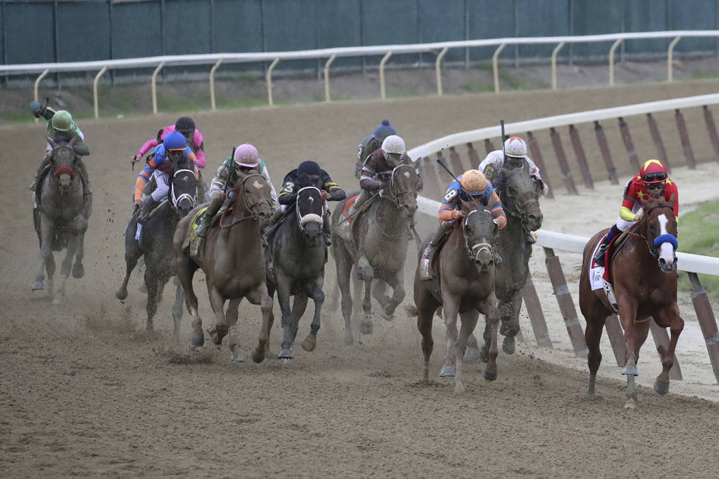 Justify, right, leads the pack in the final turn in the 1 1/2 mile Belmont Stakes on the way to winning the horse race and the Triple Crown, Saturday, June 9, 2018, at Belmont Park in Elmont, N.Y. ...