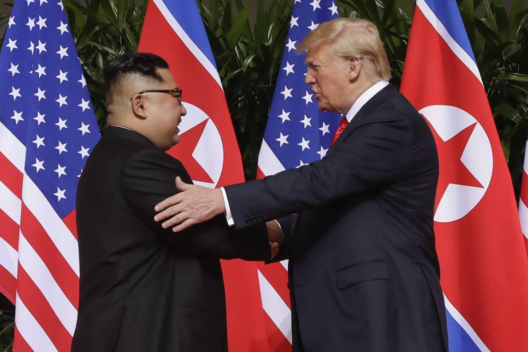 U. S. President Donald Trump shakes hands with North Korea leader Kim Jong Un at the Capella resort on Sentosa Island Tuesday, June 12, 2018 in Singapore. (AP Photo/Evan Vucci)