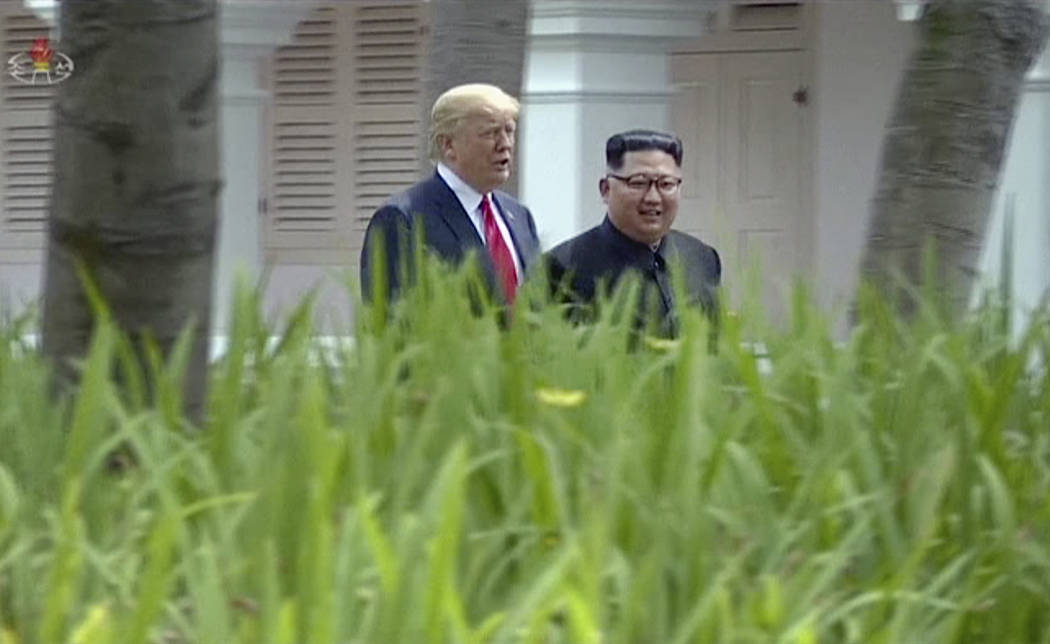 In this image made from video released by KRT on June 14, 2018, shows North Korean leader Kim Jong Un, right, walking with U.S. President Donald Trump in the garden during their summit in Singapor ...