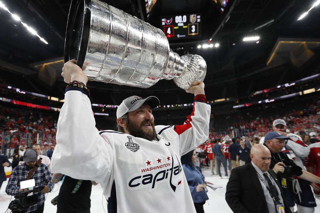 Washington Capitals left wing Alex Ovechkin holds up the Stanley Cup after the Capitals defeated the Golden Knights 4-3 in Game 5 of the NHL hockey Stanley Cup Finals Thursday, June 7, 2018, in La ...