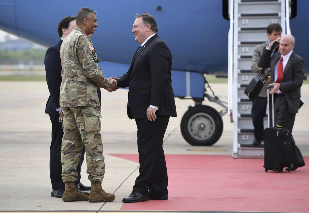 U.S. Secretary of State Mike Pompeo, center, shakes hands with U.S. General Vincent K. Brooks, commander of United States Forces Korea, upon his arrival at Osan Air Base in Pyeongtaek Wednesday, ...
