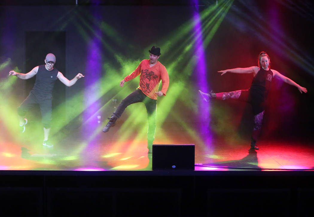"""Paul Johnson, left, Nicholas Foote, and Amanda Powell rehearse musical numbers for the annual Ribbon of Life benefit, """"The Show Must Go On"""" at the Foundry, SLS Las Vegas on Friday, June ..."""